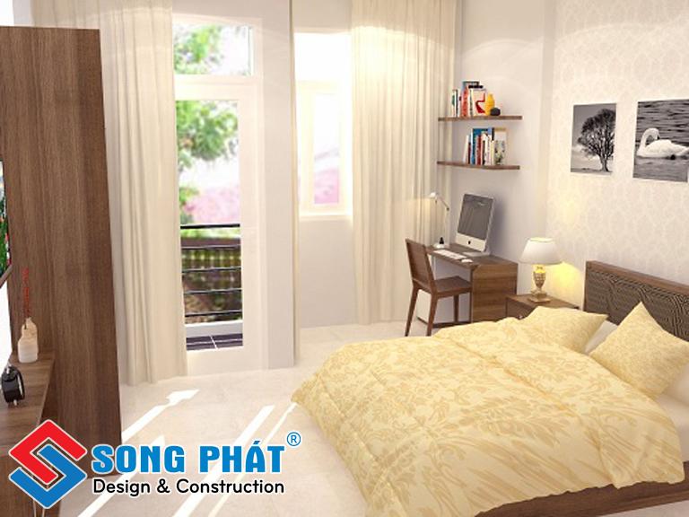 Phòng ngủ chính với một khung cửa rộng hướng ra ngoài.