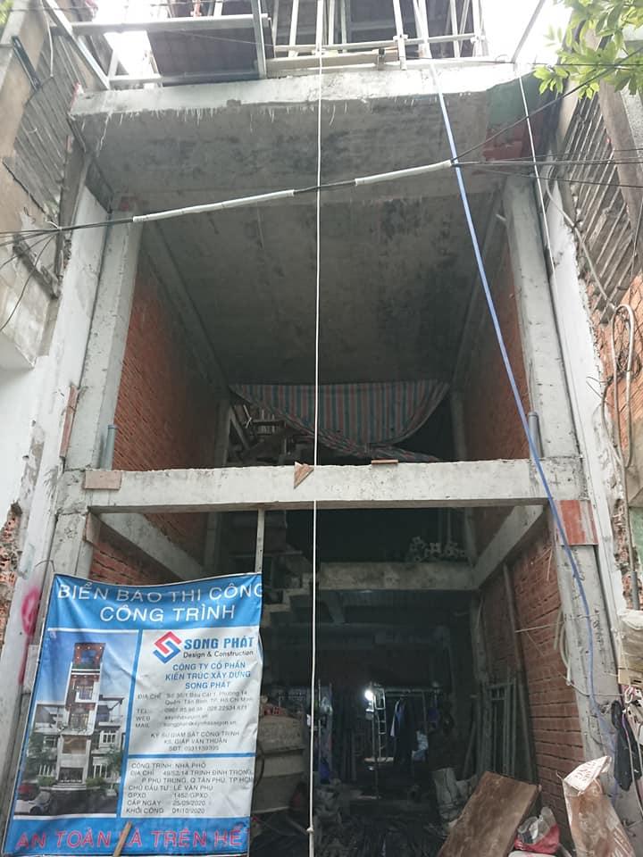 Nhà 4 tầng mặt tiền 4mx11m.